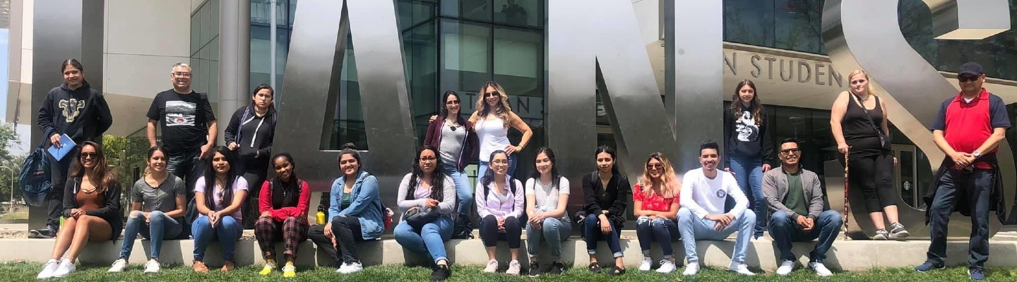 Transfer counselors and students standing in front of CSU Fullerton Student Services Building