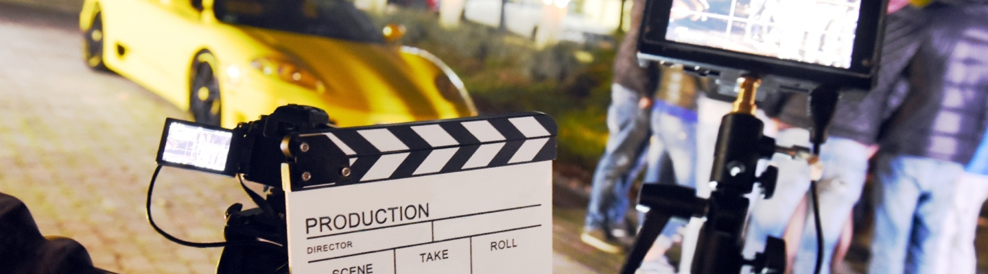 movie set with clapboard and video camera