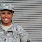 U.S. Army soldier woman of color smiling.