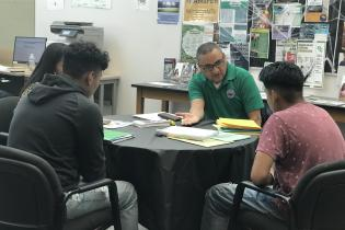 Counselor speak to students on Cash for College Event