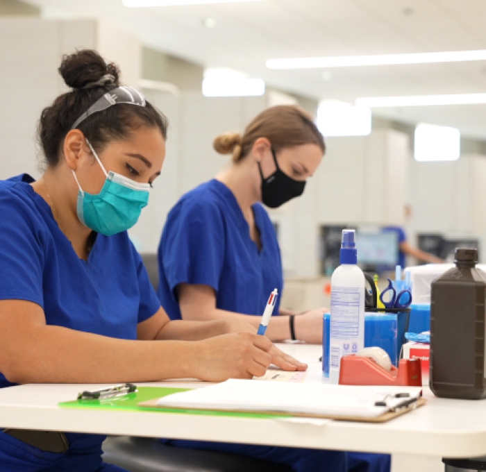 Two Dental Hygiene Students working in the Dental Lab