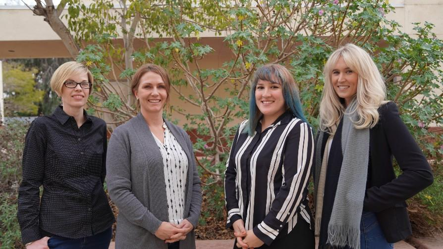 career center staff comprised of four females standing outside building